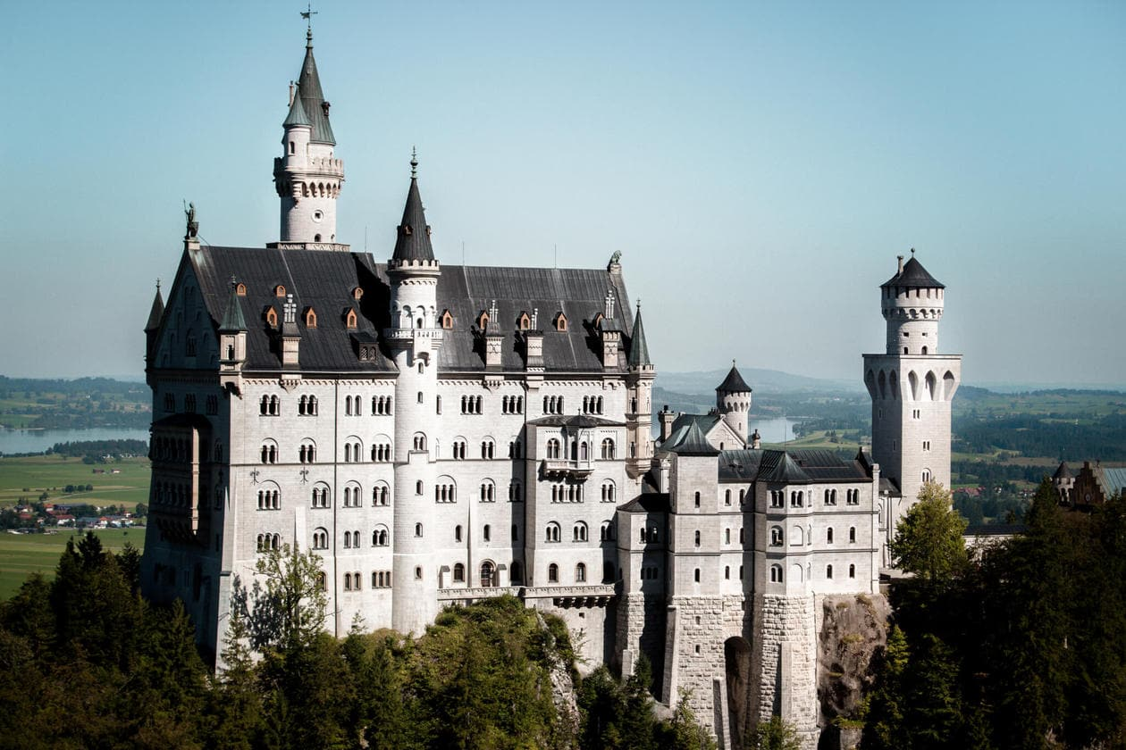 Neuschwanstein Castle is Germany's most photographed and popular fairytale castle. Keep reading for a complete guide to visiting Neuschwanstein Castle including photos, how to get there from Munich, how to buy tickets and more.