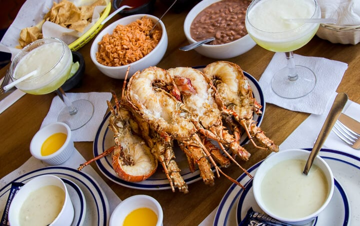 Casa de Langosta Lobster in Puerto Nuevo // Valle de Guadalupe is an up and coming wine region located in Mexico's Guadalupe Valley. With unique wineries, restaurants and hotels Valle de Guadalupe is the perfect weekend getaway from San Diego, or a great day from from Ensenada. Keep reading to discover where to eat, which wineries to visit and where to stay in Baja California's trendy hidden gem.