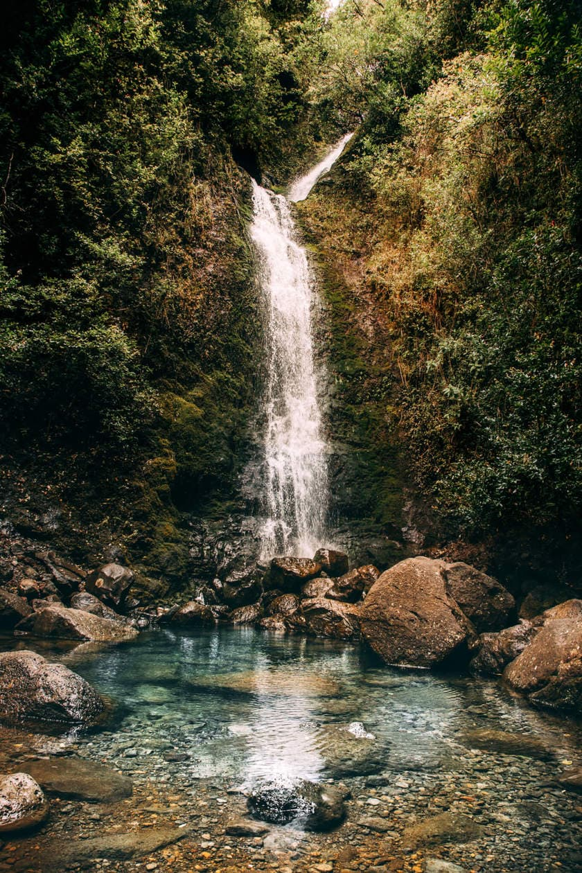 Lulumahu Falls // 20 beautiful pictures of Oahu, Hawaii that capture all of the Aloha vibes; from jungle waterfalls, white sand beaches and colorful sunsets, keep reading to ignite your wanderlust and inspire your next visit to the Hawaiian Islands.