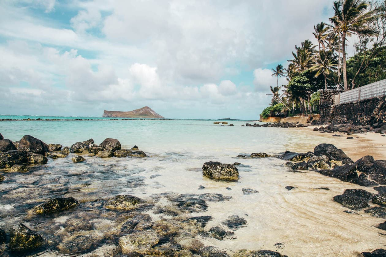 A list of 6 things to do in Oahu, from an adventurous waterfall hike to the prettiest empty beaches. Branch away from Waikiki Beach and Diamond Head, and experience a local's guide to Oahu. Discover what to eat, secret spots, visitor tips, plus 2 of the most instagrammable hotels in Oahu.