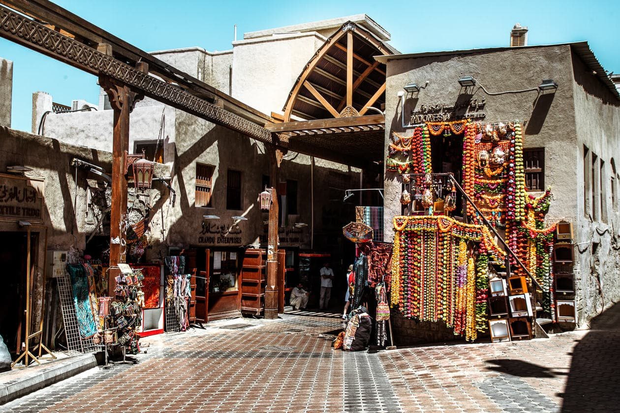 The Dubai Souks are maze of small vendors selling everything from gold to spice, perfumes and textiles.  Located in one of oldest neighborhoods in the city, Deira, the souks are a great place to buy souvenirs and haggle for gold. Keep reading for what to expect plus tips for your visit.