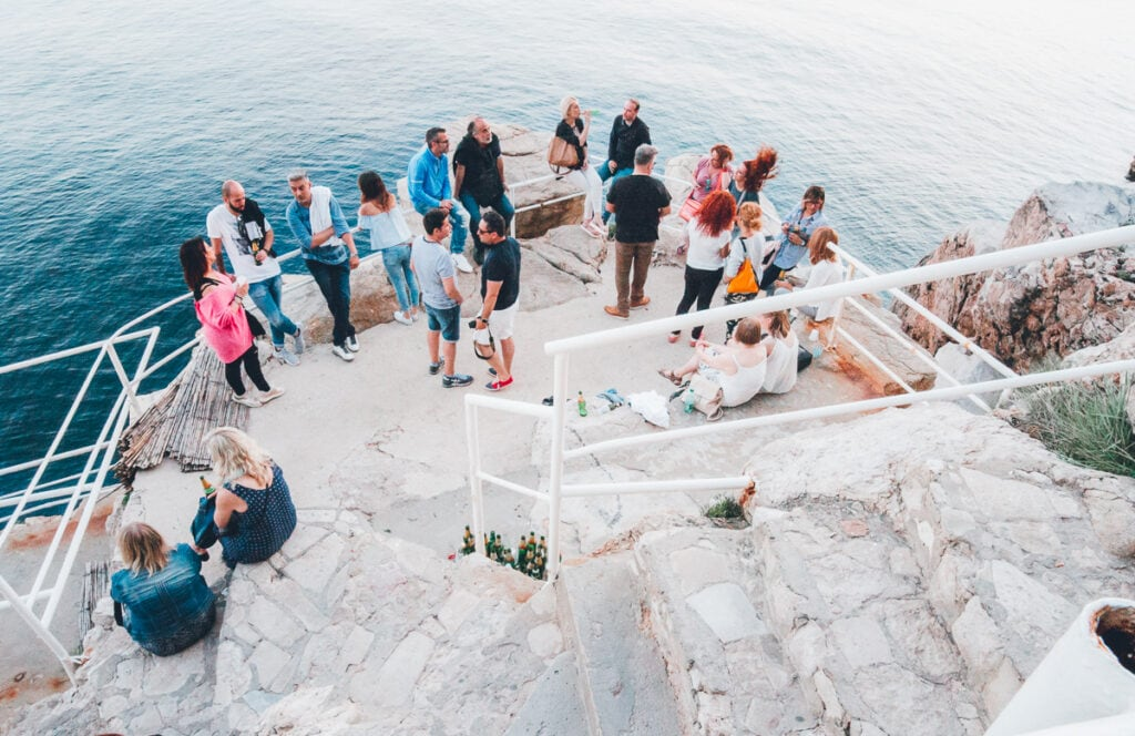 People drinking at a cliff bar in Dubrovnik