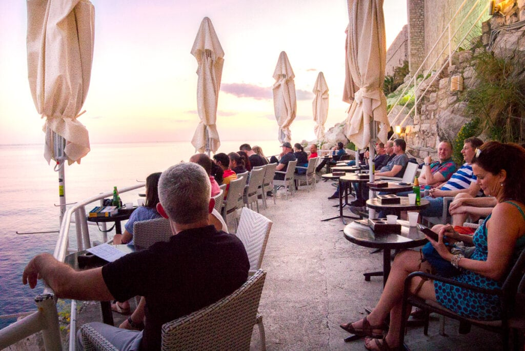 People sitting at Buza Bar in Dubrovnik, Croatia