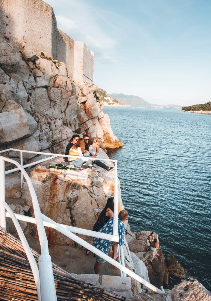 People sitting on the Dubrovnik cliffs